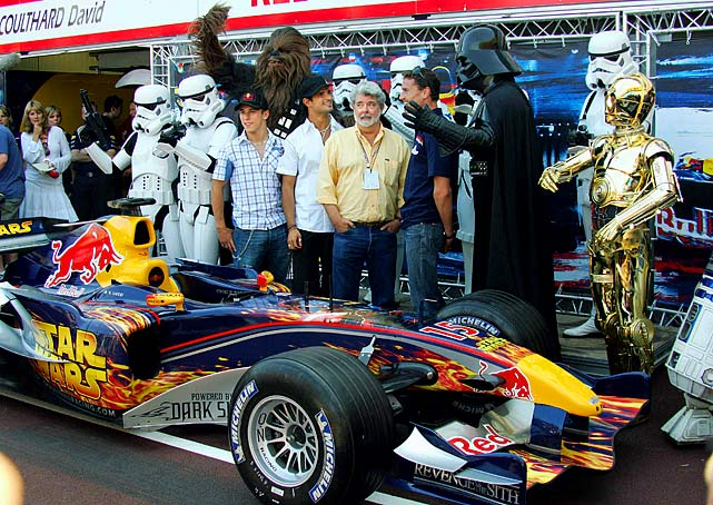 George Lucas and Red Bull Formula One driver David Coulthard, standing between Lucas and Darth Vader, pose behind the Red Bull race car on May 20, 2005 in Monte Carlo.