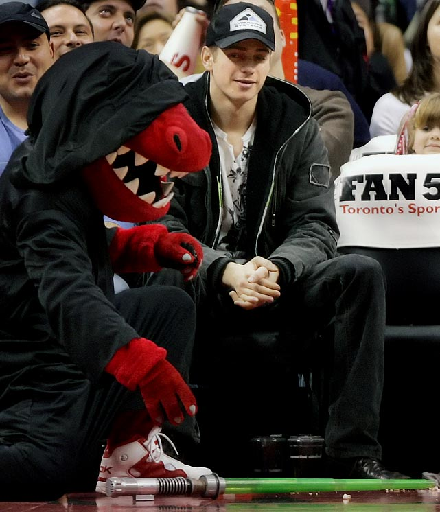 Hayden Christensen watches the Raptors mascot, dressed as a Sith, pick up a lightsaber during a time-out in a game against the Trail Blazers on Dec. 10, 2006 in Toronto.