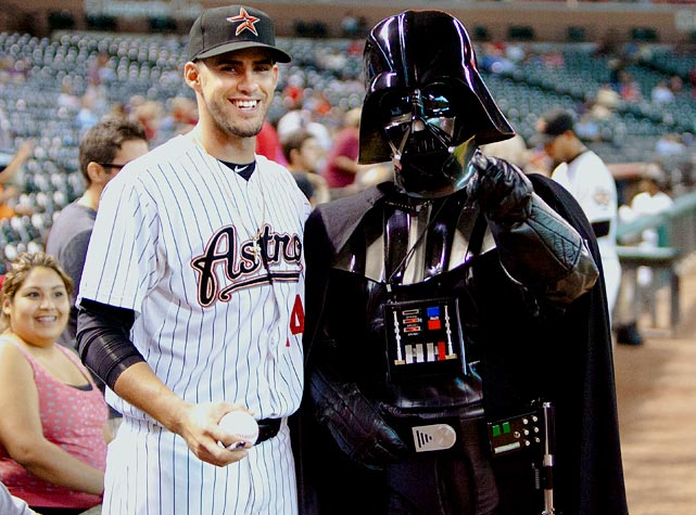 Astros left fielder J.D. Martinez poses with Darth Vader, celebrating Star Wars Night before the game against the Cardinals on Sept. 26, 2011 in Houston.