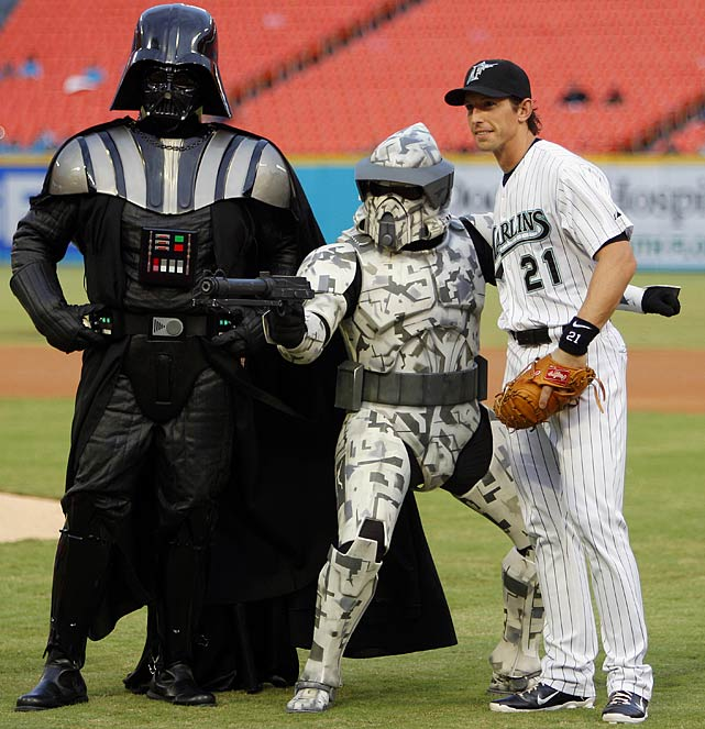 Marlins catcher John Baker poses with Darth Vader and a clone trooper before a game against the Braves on Sept. 20, 2011 in Miami.
