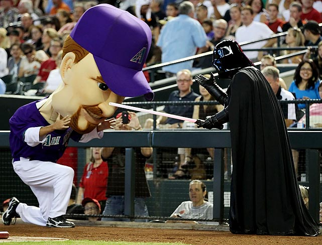 "Diamondbacks ""Legend"" Mark Grace is stopped by Darth Vader on Star Wars Day during the game against the Giants on September 25, 2011 at Chase Field in Phoenix."