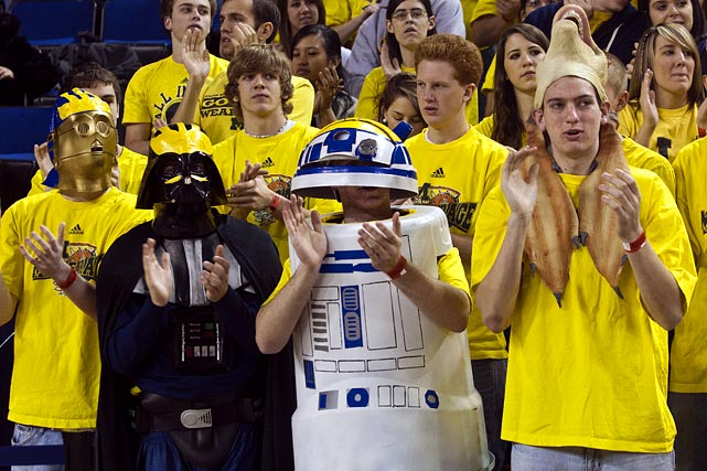 "Michigan fans in the ""Maize Rage"" student section dress as Star Wars characters during a game against Wisconsin on Feb. 6, 2010 in Ann Arbor, Michigan."