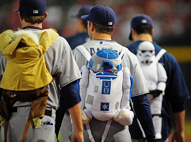 Padres relief pitchers walk to the bullpen wearing Star Wars themed backpacks prior to the game against the Diamondbacks on Aug. 28, 2011 at Chase Field in Phoenix.