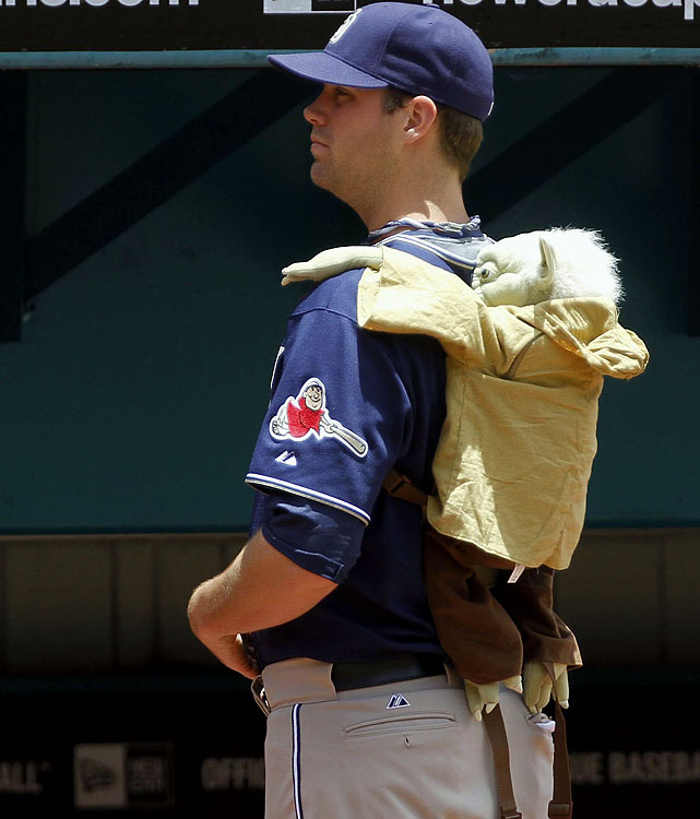 Padres relief pitcher Ryan Webb wears a Yoda doll on his back before a game against the Marlins on June 27, 2010 in Miami.