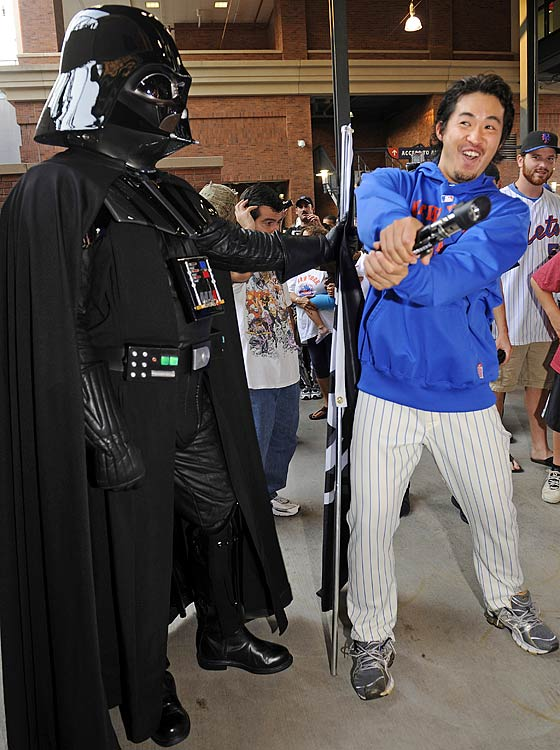 Mets pitcher Ryota Igarashi wields a lightsaber against a fan dressed as Darth Vader prior to a game against the Nationals on Sept. 13, 2011 at Citi Field in New York. The Mets hosted a contest for fans who dressed up as Star Wars characters.
