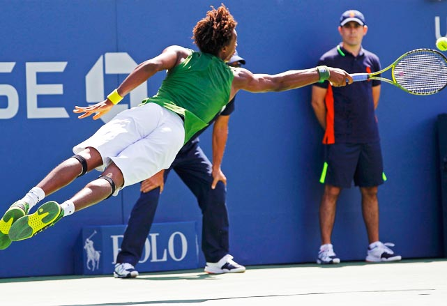 A diving volley is hard enough, but going full-on horizontal from the baseline is just crazy.