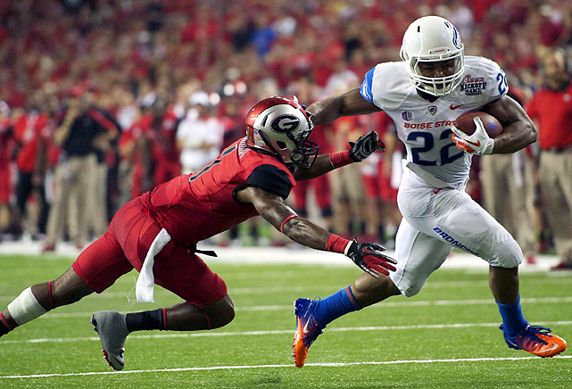 The Dawgs had new uniforms, but the Broncos had the same ol' Kellen Moore and Doug Martin. Moore completed 28-of-34 passes for 261 yards and three touchdowns and Martin (right) added 56 rushing yards and a touchdown as Boise State boosted its hopes of making another run to a major bowl.