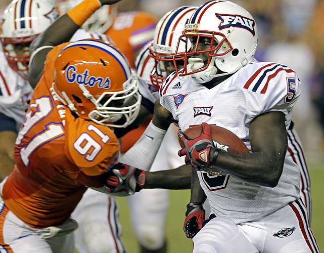 Earl Okine and Florida's defense made life difficult for Willie Floyd and Florida Atlantic, holding the Owls to 30 rushing yards and 11 first downs. John Brantley looked comfortable leading the Gators' revamped offense, Chris Rainey scored three different ways and the 22nd-ranked Gators opened the Will Muschamp era with an easy win.