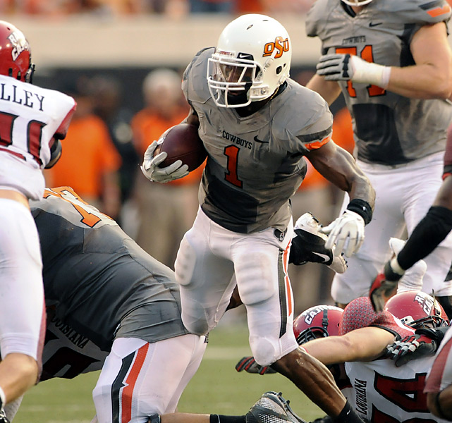 Joseph Randle (center) rushed for 129 yards and two touchdowns, Justin Blackmon had 144 yards receiving and Oklahoma State picked up where it left off last season on offense. Brandon Weeden completed 24-of-39 passes for 388 yards and three touchdowns for Oklahoma State in Todd Monken's debut as the Cowboys' offensive coordinator. Monken replaced Dana Holgorsen, who is now the head coach at West Virginia.