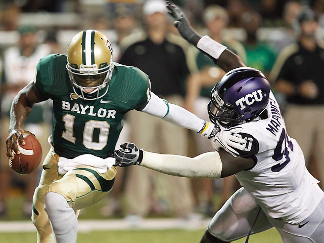 TCU had won an FBS-best 25 consecutive regular season games and last season's Rose Bowl. Baylor had not beaten a ranked team since 2004. But none of that mattered on Friday, when Robert Griffin III and the Bears held on for a thrilling 50-48 win. New TCU quarterback Casey Pachall lived up to the hype, throwing three touchdowns and rushing for another. But the Horned Frogs' typically stout defense could not contain Griffin (pictured), who was 21-of-27 for 359 yards and five touchdowns.