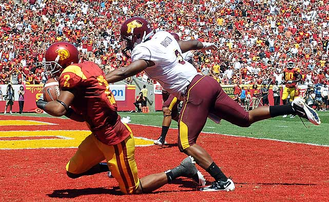 Robert Woods (pictured) caught a school-record 17 passes for 177 yards and three touchdowns; the rest of the USC offense was far less explosive, as the Trojans failed to score in the second half. But USC held on with Minnesota threatening thanks to a victory-sealing interception by Torin Harris with 53 seconds to play.