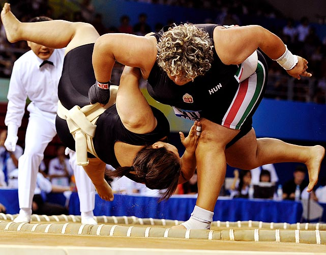 Gyongyi Kallo of the Ukraine throws her opponent to the floor.