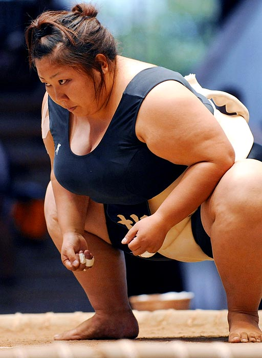 Female sumo wrestler Miki Satoyama stares down her opponent at the 2010 Japan women's sumo championships in a similar manner to a lion stalking its prey.