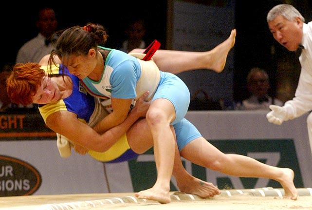 Luciana Watanabe of Brazil takes down Alina Boykova of Ukraine.