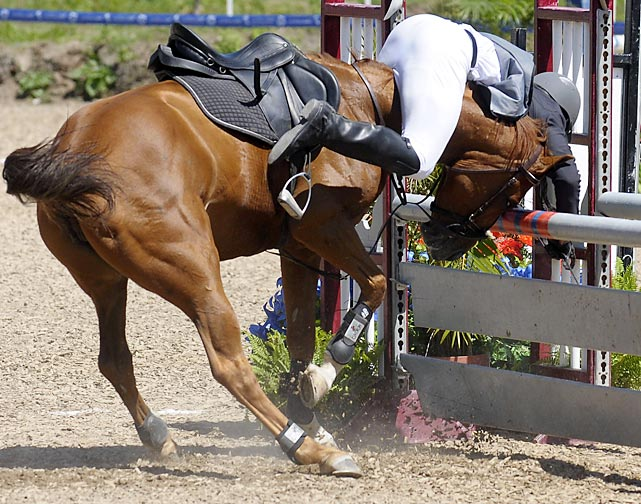 Eduardo Salas of Venezuela tries an unusual riding method during the modern pentathlon at the Pan American Games.