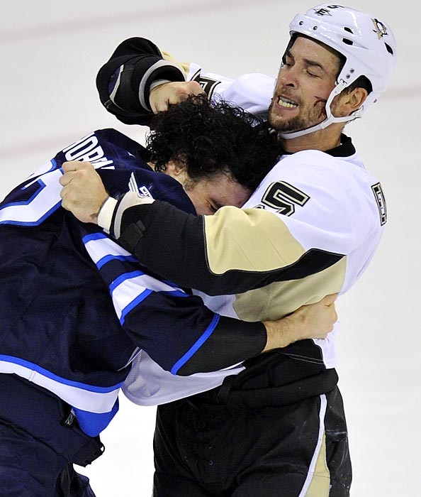 Pittsburgh's Deryk Engelland fights off a hug from Winnipeg's Chris Thorburn.