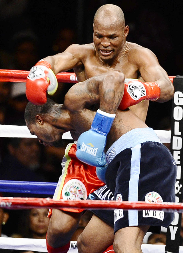 The light heavyweight champion Hopkins (rear) suffered a separated shoulder when Dawson lifted and threw him down to the canvas in the second round of a title fight. Unable to continue, Hopkins was stopped for the first time in 61 pro fights when referee Pat Russell denied the Philadelphian's claims of a foul and ruled it a technical knockout. (The ruling may be reversed pending review by the California state commission.)