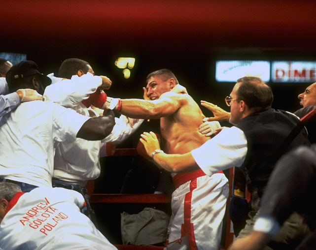 ... the first fight between Bowe and Golota, at Madison Square Garden, where the undefeated challenger was also disqualified for excessive low blows. In the aftermath, Bowe's entourage crashed the ring and attacked Golota, cracking him with a two-way radio and opening a gash that required 11 stitches. The incident prompted a melee that saw pockets of violence erupt throughout the arena.