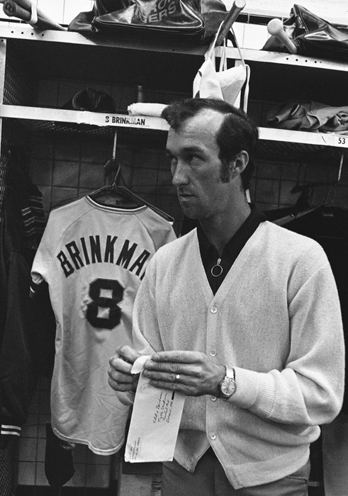 Detroit shortstop Eddie Brinkman opens mail in the clubhouse after missing a 1972 game with an ankle injury. Brinkman played for the Tigers from 1971 to '74 and won a Gold Glove Award in 1973.