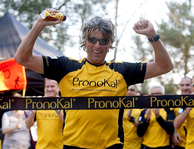 Belgian Stefaan Engels celebrates as he crosses the finish line in Barcelona during the last marathon of his 365 marathons in 365 days challenge.