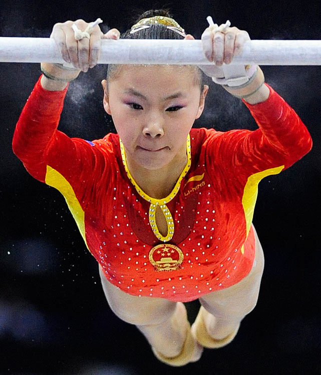He isn't even 5 feet tall, but she's a firecracker on uneven bars. At the Beijing Olympics, she won a complicated tiebreaker with Nastia Liukin to take the bars gold medal. He was also part of the Chinese team's age controversy in 2008. A gymnast must turn 16 years old during the Olympic year to compete in the Games. He's passport lists her as being born Jan. 1, 1992.