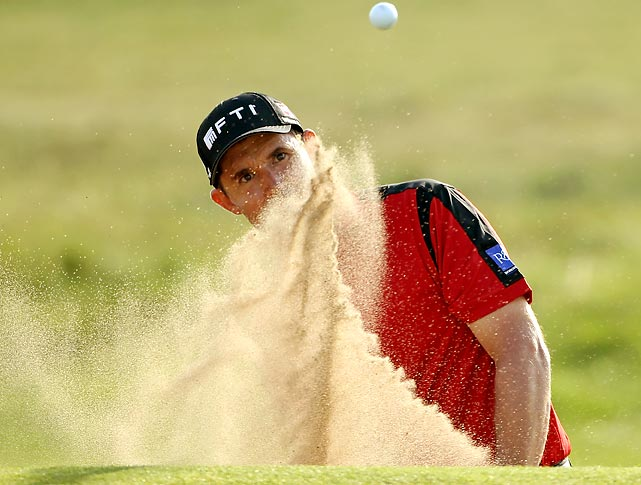 Ireland's Padraig Harrington chips out of a bunker during The Alfred Dunhill Links Championship in Scotland.