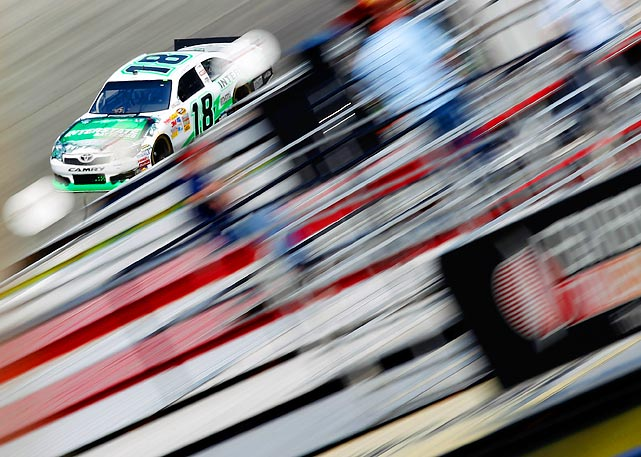 The Dover International Speedway crowd is just a blur to Kyle Busch during a practice lap for the Sprint Cup Series race.