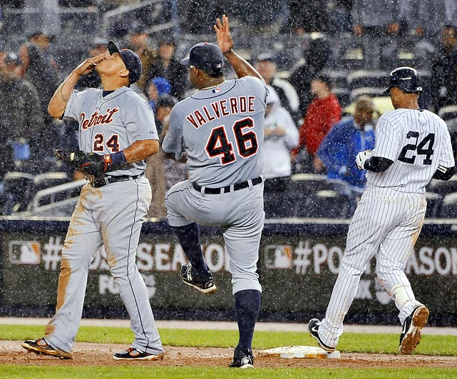 Detroit closer Jose Valverde dances in the rain after saving the Tigers' 5-3 playoff victory over the Yankees in Game 1 of their AL playoff series.