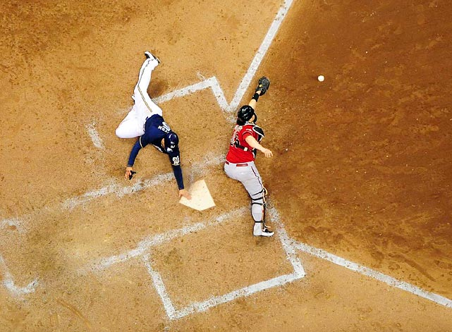 Milwaukee's Jerry Hairston Jr. scores from third on a squeeze bunt by Jonathan Lucroy in Game 2 of the Diamondbacks-Brewers divisional series. Arizona catcher Miguel Montero and his teammates fell behind 2-0 in the series with a 9-4 loss.