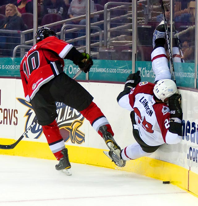Lake Erie defenseman Scott Langdon (25) gets a close-up view of the boards during a game between the Lake Erie Monsters and Abbotsford Heat in Cleveland.
