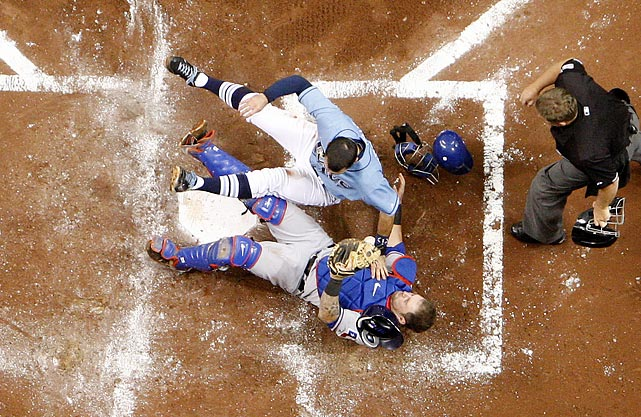 Rangers' catcher Mike Napoli endures a collision at the plate during the Texas-Tampa Bay divisional series. The Rangers won the series in four games.