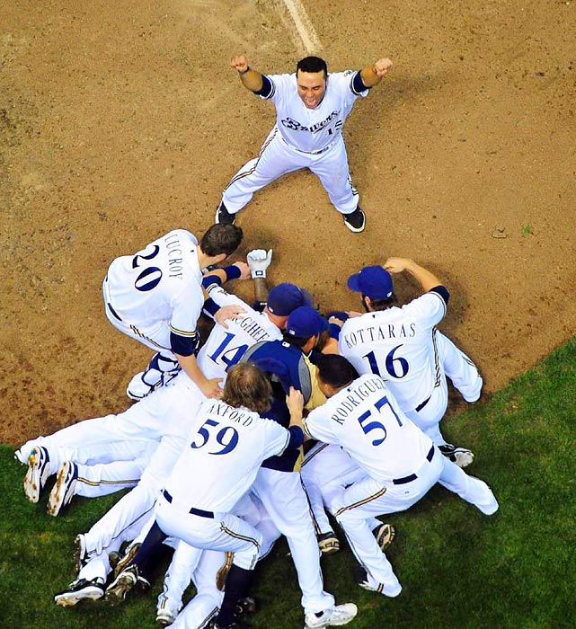 The Milwaukee Brewers celebrate their Game 5 victory over the Arizona Diamondbacks, which put them in the National League Championship Series against the St. Louis Cardinals.