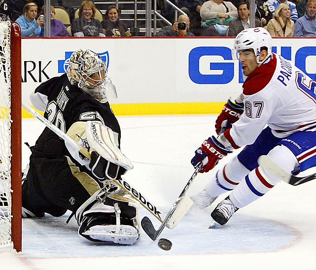 Penguins' goaltender Marc-Andre Fleury stops Canadiens winger Max Pacioretty in Pittsburgh's 3-1 victory.