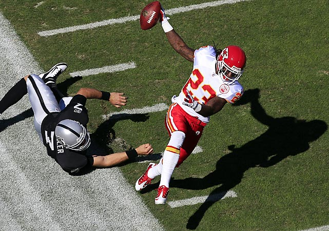 Kansas City safety Kendrick Lewis dodges Raiders' quarterback Kyle Boller on his way to a 59-yard interception return for a touchdown. Boller and Carson Palmer each tossed three picks in the Raiders 28-0 loss.