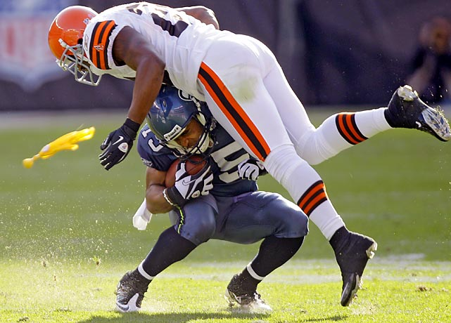 Seattle wide receiver Doug Baldwin is hit by Cleveland linebacker Kaluka Maiava. The catch was nullified after Baldwin was called for offensive pass interference. The Browns won 6-3.