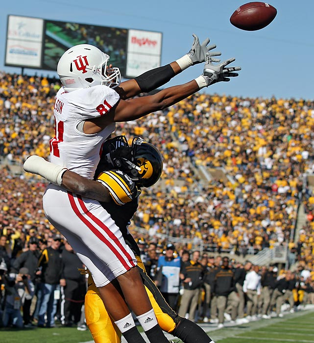 Iowa's B.J. Lowery defends Indiana wideout Duwyce Wilson, who couldn't haul in this pass during a 45-24 loss.