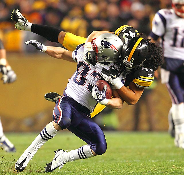 Steelers safety Troy Polamalu tackles Patriots wideout Wes Welker during Pittsburgh's 25-17 win over New England.