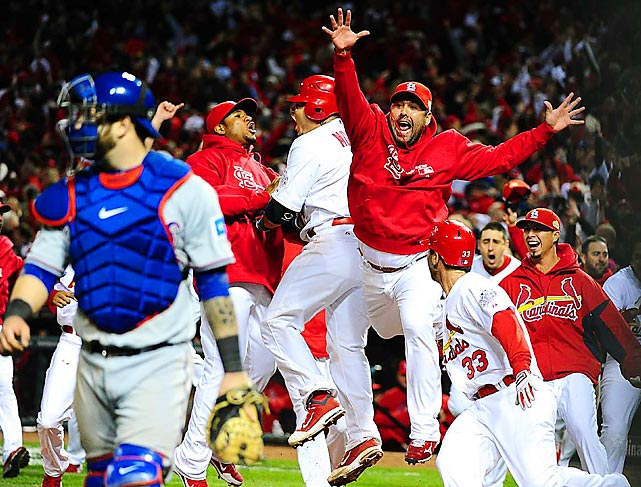 Gerald Laird celebrates with St. Louis teammates after David Freese hit a solo home run in the 11th inning of Game 6 of the World Series. Freese also hit a game-tying double in the ninth with the Cardinals a strike away from being eliminated. He went on to be named World Series MVP.