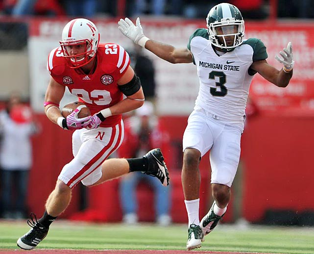 Nebraska defensive back Lance Thorell intercepts a pass intended for wide receiver B.J. Cunningham. Spartans quarterback Kirk Cousins was held to 86 passing yards in the 24-3 loss.