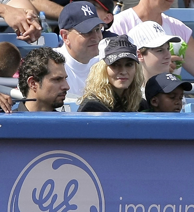 Madonna enjoys her seat along the third base line during a 2008 Reds-Yankees game at Yankee Stadium.