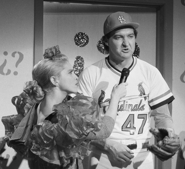 Prior to  A League Of Their Own , Madonna's only baseball experience was playing the role of interviewer to Randy Quaid (dressed as Cardinals pitcher Joaquin Andujar) during a November 1985 episode of  Saturday Night Live.