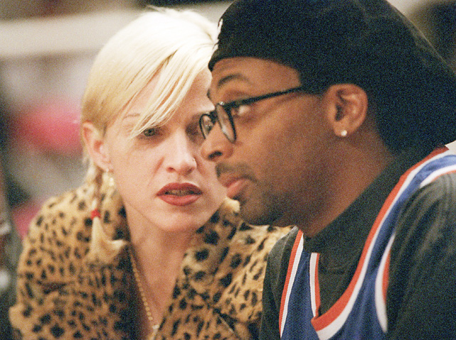 Madonna can't get enough of the Knicks, as she attends another game at Madison Square Garden and talks to the team's No. 1 fan, Spike Lee.
