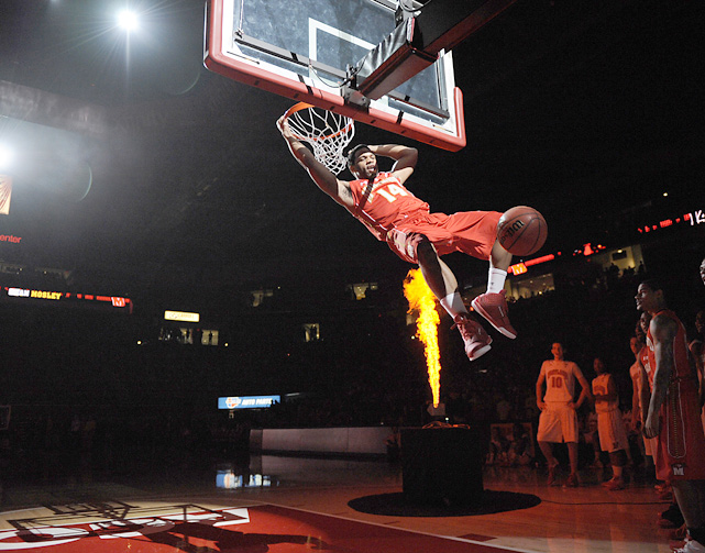 Maryland's Sean Mosley hangs on the rim during the team's Midnight Madness festivities.