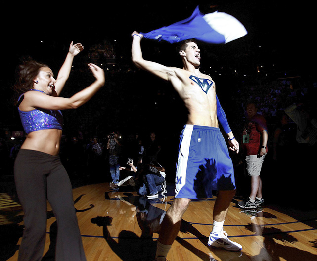 Memphis' Drew Barham rips off his jersey to show his superman style ''M'' painted on his chest while being introduced  during Memphis Madness at the The FedExForum.