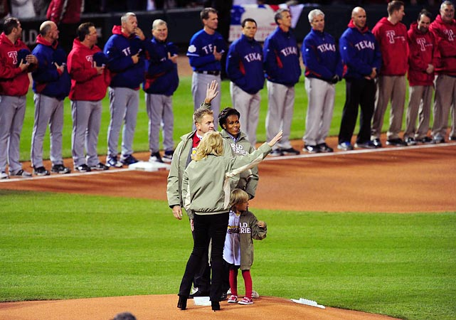 Michelle Obama waves to fans at Busch Stadium as she stands on the mound with Jill Biden, Lance Corporal James Sperry and Sperry's 5-year-old daughter, Hannah. For the third year in a row the World Series was dedicated to America's military.