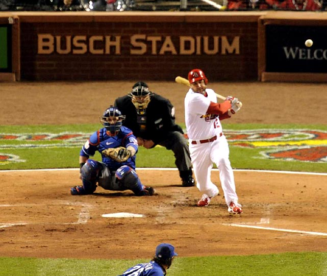 Lance Berkman makes contact with a C.J. Wilson pitch. Berkman went 2-4 and his two RBI single in the fourth inning gave the Cardinals a 2-0 lead.
