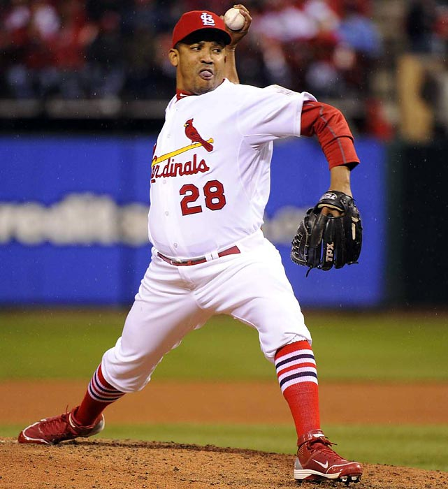 Cardinals' reliever Octavio Dotel throws a pitch during the eighth inning. The set-up man pitched two-thirds of the inning, getting Ian Kinsler and Elvis Andrus out.