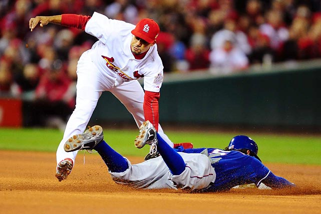 St. Louis shortstop Rafael Furcal tags out Ian Kinsler as he attempts to steal second base in the first inning.