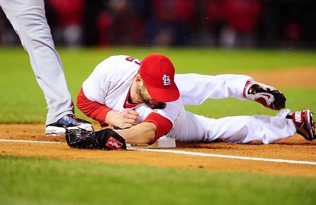 St. Louis ace Chris Carpenter  laid out to cover first base and get Texas shortstop Elvis Andrus out in the first inning.