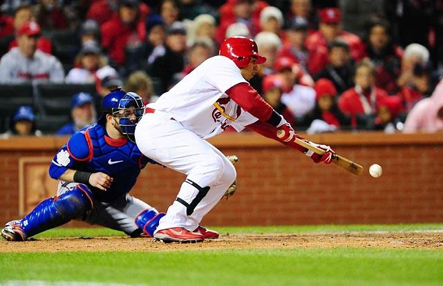 Cardinals' centerfielder Jon Jay lays down a sacrifice bunt in the fifth inning.